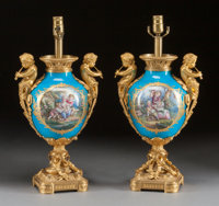 A PAIR OF SÈVRES-STYLE PORCELAIN AND FIGURAL GILT BRONZE MOUNTED LAMP BASES Early 20th century 21-3/4 inches h