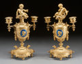 Decorative Arts, French:Lamps & Lighting, A PAIR OF FRENCH GILT BRONZE AND ENAMEL TWO-LIGHT FIGURALCANDELABRA . 19th century. 11 inches high (27.9 cm). ... (Total: 2Items)