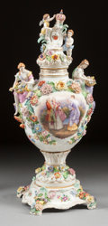 Ceramics & Porcelain, Continental:Other , A GERMAN PORCELAIN FIGURAL COVERED URN . 19th century. 28-1/2inches high (72.4 cm). ...