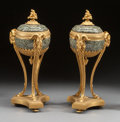 Decorative Arts, French, A PAIR OF LOUIS XVI-STYLE MARBLE AND GILT BRONZE COVERED URNS .20th century. 19-1/2 high x 8 inches wide (49.5 x 20.3 cm). ...(Total: 2 Items)