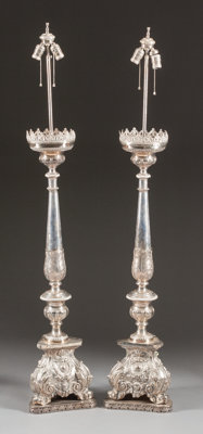 A PAIR OF ITALIAN BAROQUE-STYLE SILVERED METAL PRICKETS MOUNTED AS LAMPS 20th century 59-1/2 inches high (151.1