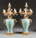 Decorative Arts, French:Lamps & Lighting, A PAIR OF LOUIS XV-STYLE CELADON, PORCELAIN AND GILT BRONZEURN-FORM SEVEN-LIGHT CANDELABRA. 20th century. 40 inches high x ...(Total: 2 Items)