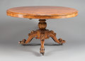 Furniture , A GEORGE IV BURL WALNUT VENEERED CENTER TABLE. Circa 1810. 30-1/2 inches high x 54 inches diameter (77.5 x 137.2 cm). ...