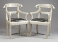 Furniture , A PAIR OF INDIAN SILVERED METAL REPOUSSÉ AND LEATHER UPHOLSTERED ARM CHAIRS . 20th century. 34 x 23 x 17 inches (86.4 x 58.4... (Total: 2 Items)