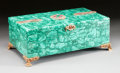 Decorative Arts, Continental, A RUSSIAN RUBY AND EMERALD ENCRUSTED MALACHITE TABLE BOX. Early20th century. 6-1/8 x 16-1/2 x 10-1/2 inches (15.6 x 41.9 x ...