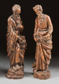 Decorative Arts, Continental:Other , A PAIR OF ITALIAN GOTHIC-STYLE CARVED WOOD FIGURES OF ST. MATTHEWAND ST. LUKE. 18th century. 31 inches high (78.7 cm) (tall...(Total: 2 Items)