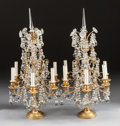 Decorative Arts, French:Lamps & Lighting, A PAIR OF LOUIS XVI-STYLE GILT BRONZE AND CUT GLASS GIRANDOLES.Early 20th century. 29 inches high (73.7 cm). ... (Total: 2 Items)