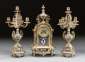 Decorative Arts, French:Lamps & Lighting, A THREE PIECE FRENCH GILT BRONZE AND CHAMPLEVÉ ENAMEL CLOCKGARNITURE. 19th century. 18-1/2 inches high (47.0 cm) (clock). ...(Total: 3 Items)
