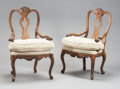 Furniture , A PAIR OF ITALIAN WALNUT UPHOLSTERED ARM CHAIRS. Early 20th century. 42 x 25 x 23 inches (106.7 x 63.5 x 58.4 cm). ... (Total: 2 Items)