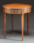 Furniture : French, A NAPOLEON III MAHOGANY VENEERED AND GILT BRONZE GUERIDON WITHSINGLE DRAWER . Circa 1860. 29-1/2 x 26-3/4 inches (74.9 x 67...