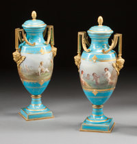 A PAIR OF SÈVRES-STYLE ENAMELED BLUE PORCELAIN AND GILT BRONZE MOUNTED COVERED VASES 19th century 17 x 7-1/2 x