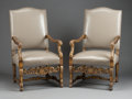 Furniture : French, A PAIR OF FRENCH RÉGENCE-STYLE PARCEL GILT CARVED WOOD AND GRAYLEATHER UPHOLSTERED ARM CHAIRS. Second half 19th century. 45...(Total: 2 Items)