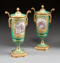 A PAIR OF SÈVRES-STYLE PAINTED PORCELAIN AND GILT BRONZE MOUNTED COVERED URNS Circa 1900 Marks: (C-crossed arro...