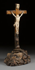 Decorative Arts, French, A FRENCH CARVED IVORY AND WOOD CRUCIFIX. 19th century. 26-3/4 x 12x 7-1/2 inches (67.9 x 30.5 x 19.1 cm). ...