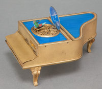 A BRASS AND GUILLOCHÉ ENAMEL PIANO-FORM MUSIC BOX Maker unknown, 20th century 2-5/8 x 6-1/4 x 3-3/4 inches (6