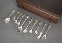 A ONE HUNDRED FIFTY-FOUR PIECE REED & BARTON LOVE DISARMED PATTERN SILVER AND SILVER GILT PA