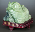 Asian:Chinese, A CHINESE CARVED JADEITE FROG SCULPTURE. 20th century. 15 incheshigh x 13 inches wide (38.1 x 33.0 cm) (with stand). ...