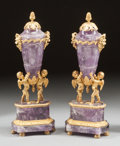 Decorative Arts, French:Other , A PAIR OF CONTINENTAL LOUIS XVI-STYLE AMETHYST AND GILT BRONZE MOUNTED FIGURAL URNS. 20th century. Marks: (spurious Russian ... (Total: 2 Items)