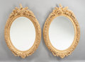 Decorative Arts, French, A PAIR OF LOUIS XVI-STYLE CARVED GILT WOOD OVAL MIRRORS. Circa1900. 46 inches high x 33 inches wide (116.8 x 83.8 cm). ...(Total: 2 Items)