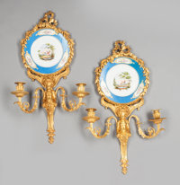 A PAIR OF LOUIS XVI-STYLE GILT BRONZE AND SÈVRES-STYLE PORCELAIN TWO-LIGHT WALL SCONCES Second half 20th century