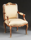 Furniture : French, A LOUIS XV-STYLE MAHOGANY AND GILT BRONZE UPHOLSTERED ARM CHAIR .20th century. 40 x 25-1/2 x 30 inches (101.6 x 64.8 x 76.2...