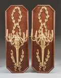 Decorative Arts, French:Lamps & Lighting, A PAIR OF FRENCH GILT BRONZE FIVE-LIGHT WALL SCONCES MOUNTED ONWOOD PANELS. Early 20th century. 58 inches high x 19-1/2 inc...(Total: 2 Items)