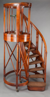 AN EDWARDIAN MAHOGANY CIRCULAR STAIRCASE Circa 1905 106 inches high x 54 inches wide (269.2 x 137.2 cm)