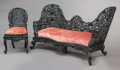 Asian:Other, AN ASIAN CARVED EBONIZED WOOD PARLOR SETTEE AND CHAIR . Makerunknown, Early 20th century. 37 x 69 x 32-1/2 inches (94.0 x 1...(Total: 2 Items)