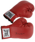 Boxing Collectibles:Autographs, Muhammad Ali Signed Boxing Gloves. The right glove of this pair of Everlast boxing gloves sports a perfect black ink signat...