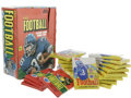 Football Collectibles:Others, 1980 & 1985 Topps Sealed Wax Packs Lot of 20 With Display Box. Twenty sealed wax packs from Topps' football issues are offe... (Total: 20 Items)