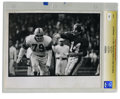 Football Collectibles:Photos, Circa 1960s Y. A. Tittle Vintage Photograph. HOF quarterback Y. A.Tittle is depicted as he flings the ball away under the...