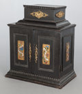 Decorative Arts, Continental, A CONTINENTAL BAROQUE-STYLE EBONIZED WOOD AND ENAMELED METAL TABLECABINET. Late 19th/early 20th century. 15 x 13-1/4 x 8-3/...