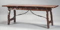 Furniture : Continental, AN ITALIAN BAROQUE-STYLE CARVED WALNUT TRESTLE TABLE. 18th centuryand later. 31 x 83-1/2 x 28 inches (78.7 x 212.1 x 71.1 c...