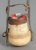 African, AN AFRICAN IVORY, WOOD AND BEADWORK CONTAINER ON CHAIN. 19th/20thcenturies. 2-3/4 inches long (7.0 cm) (container). ...