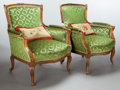 Furniture : French, A PAIR OF FRENCH PROVINCIAL CARVED WALNUT BERGÈRES. 20th century.39-1/2 x 33-1/2 x 34 inches (100.3 x 85.1 x 86.4 cm). ... (Total: 2Items)