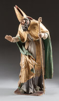 Decorative Arts, Continental, AN ITALIAN CARVED WOOD PAINTED FIGURE OF A SAINT. 18th century.55-1/2 x 14 x 18 inches (141.0 x 35.6 x 45.7 cm). ...