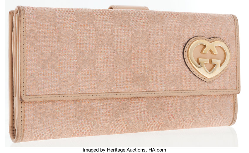 9513f05cd47 Gucci Pink Monogram Canvas Wallet with Gold Heart Accent. ...