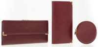 Cartier Set of Three; Burgundy Leather Wallets and Coin Purse