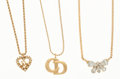 """Luxury Accessories:Accessories, Christian Dior Set of Three: Gold Tone Metal Heart Necklace withYellow Rhinestones, Gold Tone Metal """"CD"""" Monogram Necklace, R..."""