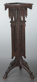 Furniture , AN SOUTH EAST ASIAN CARVED HARDWOOD PLANT STAND WITH ELEPHANT DETAIL. Circa 1900. 45 inches high x 16-1/2 inches wide (114.3...