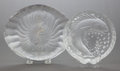 Glass, TWO LALIQUE FROSTED AND CLEAR GLASS ASH TRAYS. Post 1945. Marks: LALIQUE, FRANCE. 2-5/8 x 8-1/2 x 7 inches (6.7 x 21.6 x... (Total: 2 Items)