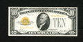 Small Size:Gold Certificates, Fr. 2400 $10 1928 Gold Certificate. About Uncirculated.. A lightly circulated gold certificate with bright ink colors, broad...