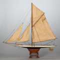 Maritime:Decorative Art, A CARVED WOOD SAILBOAT SCALE SHIP MODEL ON STAND. Early 20thcentury. 35-1/2 inches high x 34-1/2 inches long (90.2 x 87.6 c...