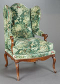 Furniture , A FRENCH PROVINCIAL WALNUT WING-BACK CHAIR WITH FLEMISH NEEDLEPOINT UPHOLSTERY. 20th century. 45-1/4 x 27 x 34 inches (114.9...