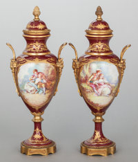 A PAIR OF SÈVRES-STYLE GILT BRONZE MOUNTED HANDLED URNS Circa 1900 Marks to bronze: EV 19 inches