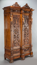 Furniture : Continental, A TUSCAN CARVED WALNUT ARMOIRE. 19th century. 95-1/2 x 55 x 22inches (242.6 x 139.7 x 55.9 cm). ...