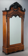 Furniture : French, A NAPOLEON III CARVED WALNUT BONNETIÈRE. 19th century. 100 x 45-1/2x 20 inches (254 x 115.6 x 50.8 cm). ...