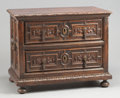 Furniture : Continental, A SPANISH BAROQUE CARVED MAHOGANY TWO-DRAWER CHEST. 17th century.35 x 44-1/2 x 26 inches (88.9 x 113.0 x 66.0 cm). ...