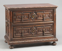 A SPANISH BAROQUE CARVED MAHOGANY TWO-DRAWER CHEST 17th century 35 x 44-1/2 x 26 inches (88.9 x 113.0 x 66.0 cm