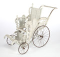 Furniture , AN AMERICAN PAINTED WICKER UPRIGHT BUGGY IN THE MANNER OF HEYWOOD BROTHERS & WAKEFIELD COMPANY . Circa 1900. 36-1/2 x 20-1/2...